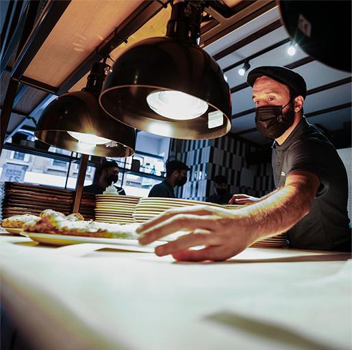 pizza chef working in manchester pizza restaurant