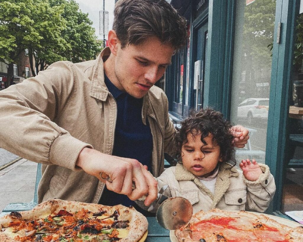father and daughter eating pizzas at Purezza Camden
