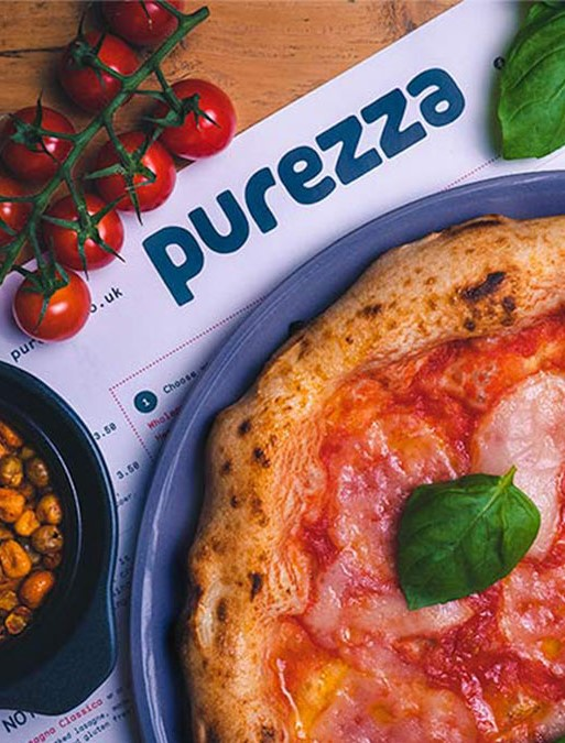 purezza margherita sat on a menu surrounded by vegetables