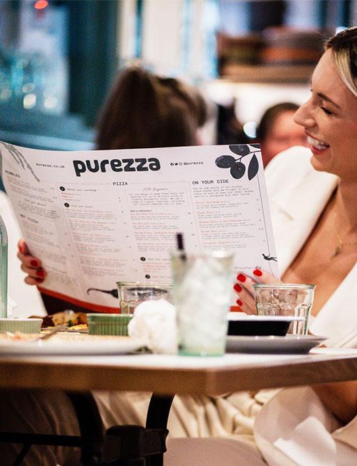 Purezza woman smiling at the menu